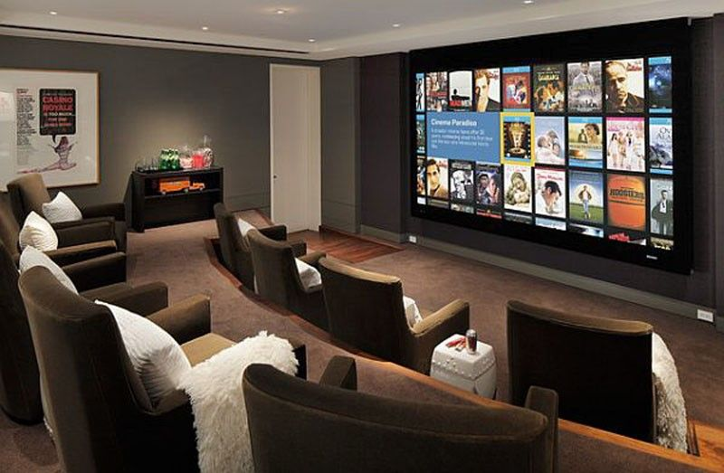 The Red And Beige Cinema Room At Home Media Room Ideas With Decorative Wall And Plush Seating Media Room Media Room Design Home Cinema Room Home Theater Rooms