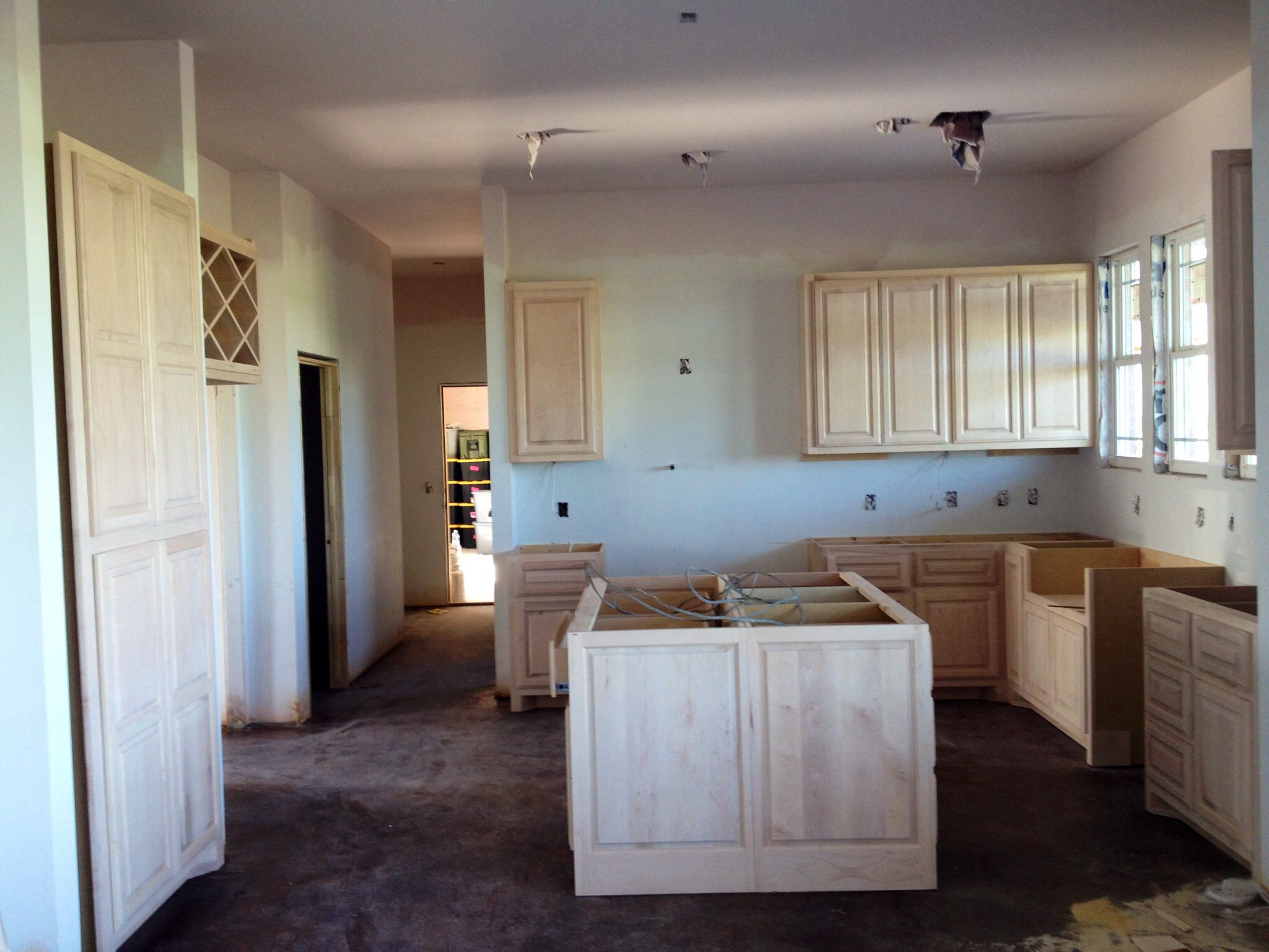 Unfinished kitchen cabinets, being painted now. (With ...