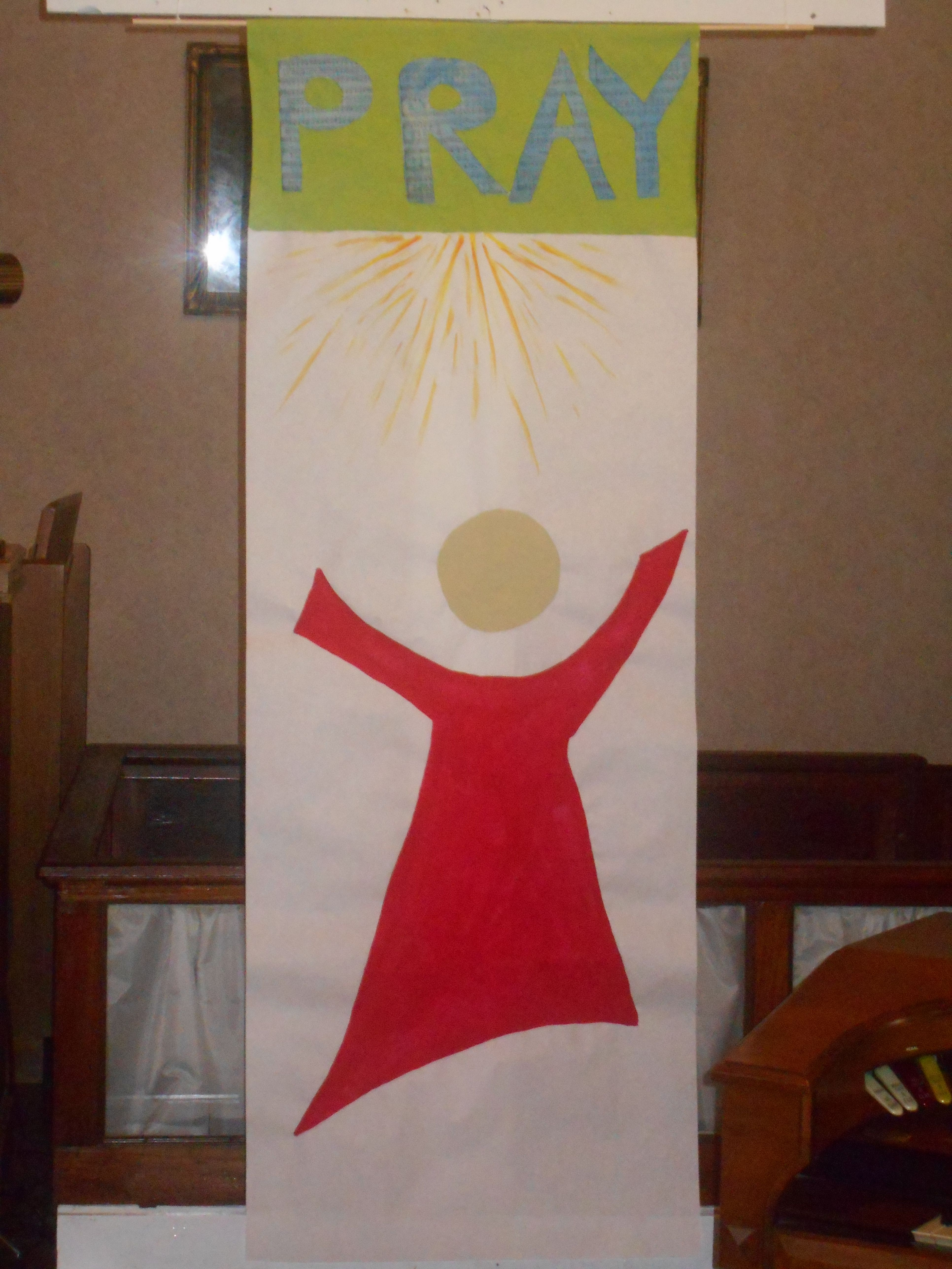 Banner created from white butcher paper and acrylic paint  Used for