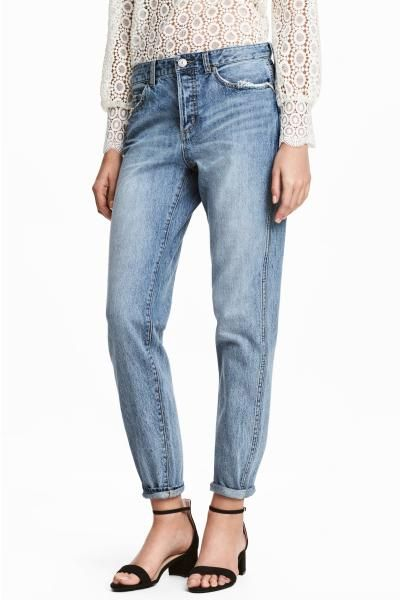 5-pocket, low-rise jeans in washed denim with hard-worn details, a button fly and slightly wider, tapered legs.