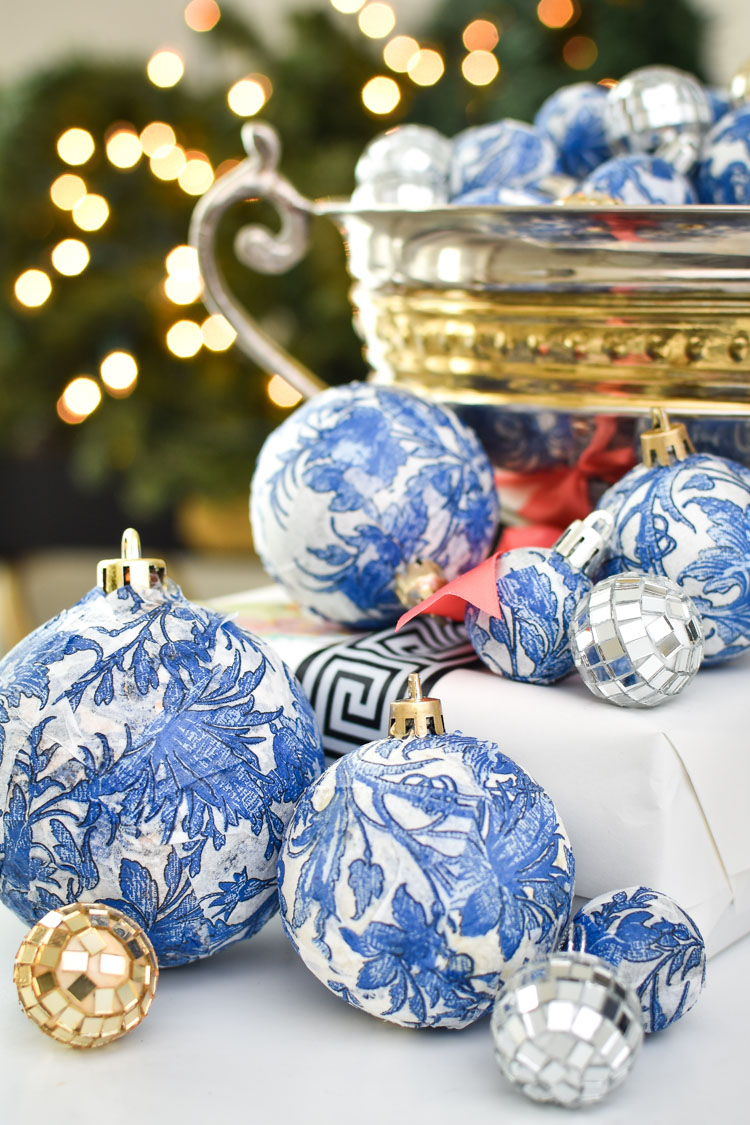 Make DIY chinoiserie blue, white, gold and silver Christmas ornaments for cheap using dollar store supplies and mod podge! Chic, affordable and stylish holiday decorations and crafts. | #christmasdecor #christmasdecorationideas #christmascrafts #christmasdecorations #christmasdecorationsDIY #christmasdecorating #holidaydecor #holidayseason #holidaydecorations #holidaycrafts