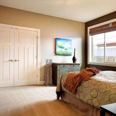 i like the dark brown accent wall with the neutral tan walls