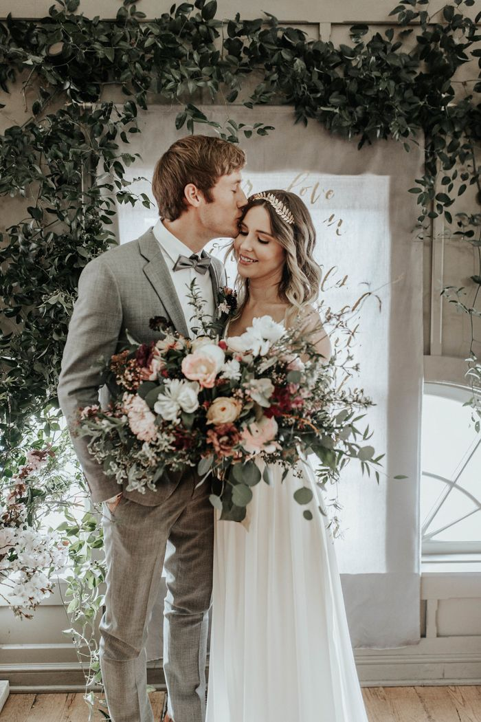 Look no further than the incredible florals, calligraphy backdrop, and intimate setting for inspiration on how to add some enchantment to your wedding day | Image by Karra Leight Photography