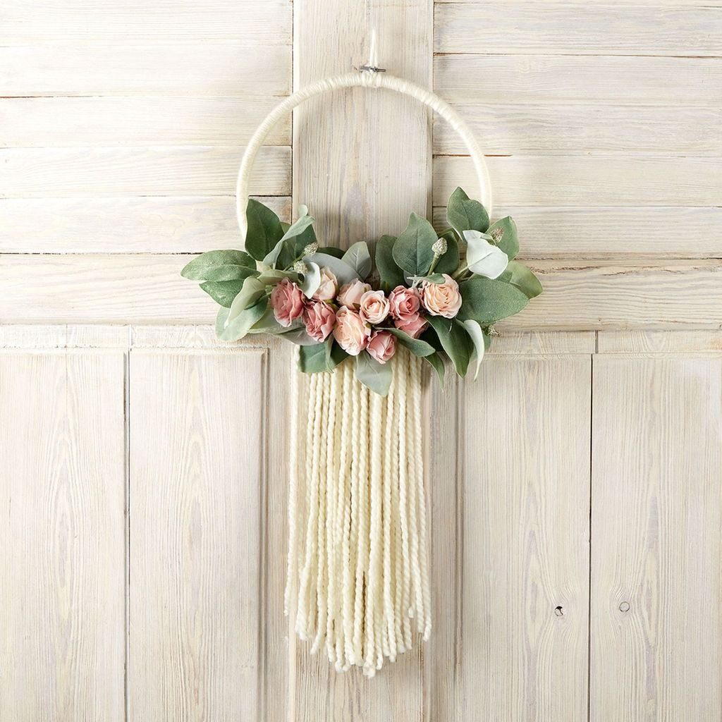 Make this easy DIY Floral and Yarn Wreath in colors to