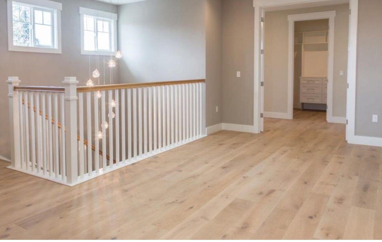Blonde Wood Floors Wide Hallway With