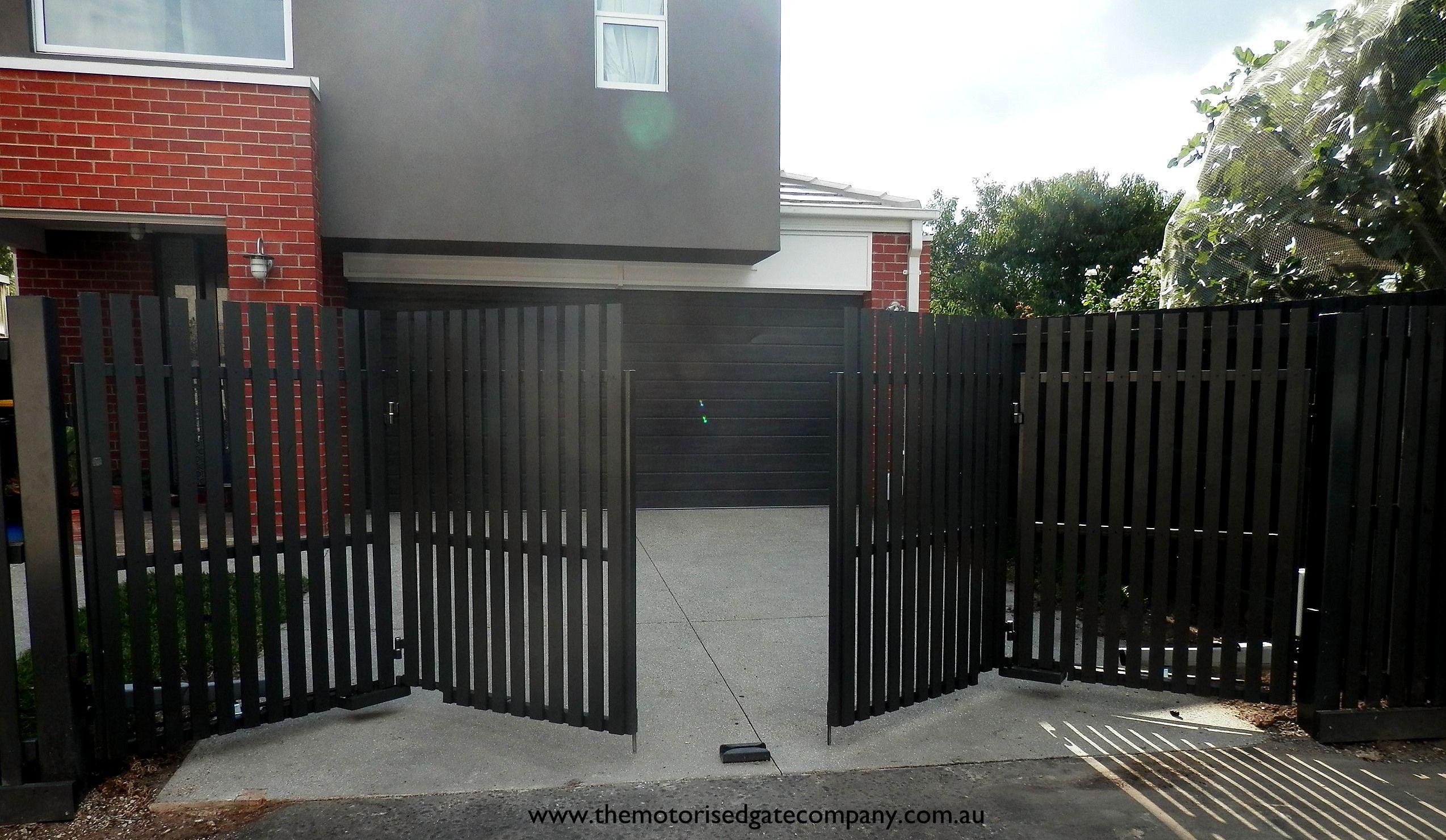 No 26 Tmgc Automatic Trackless Bi Fold Gates Timber Picket Monument Grey Faac Gate Operators Www Themotoris Automatic Gate Driveway Gate Sliding Gate