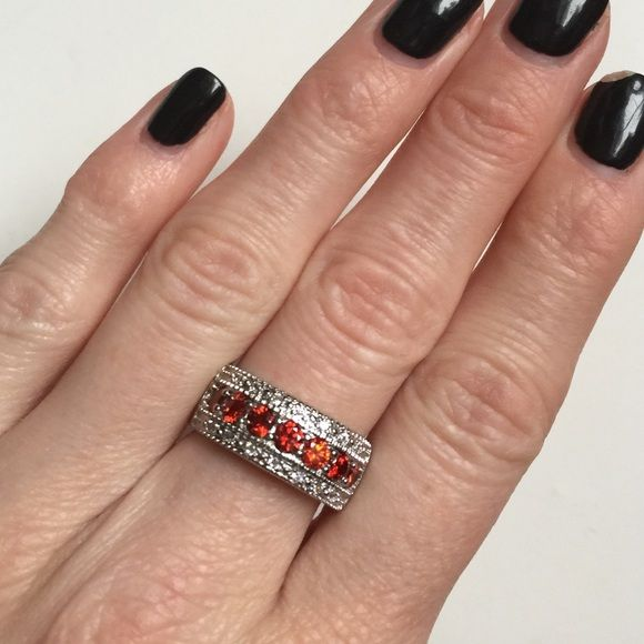 NWOT .925 CZ and Faux Ruby Ring NWOT In love with this! Faux ruby and CZ diamonds. Sterling silver .925. Price firm unless bundled Jewelry Rings