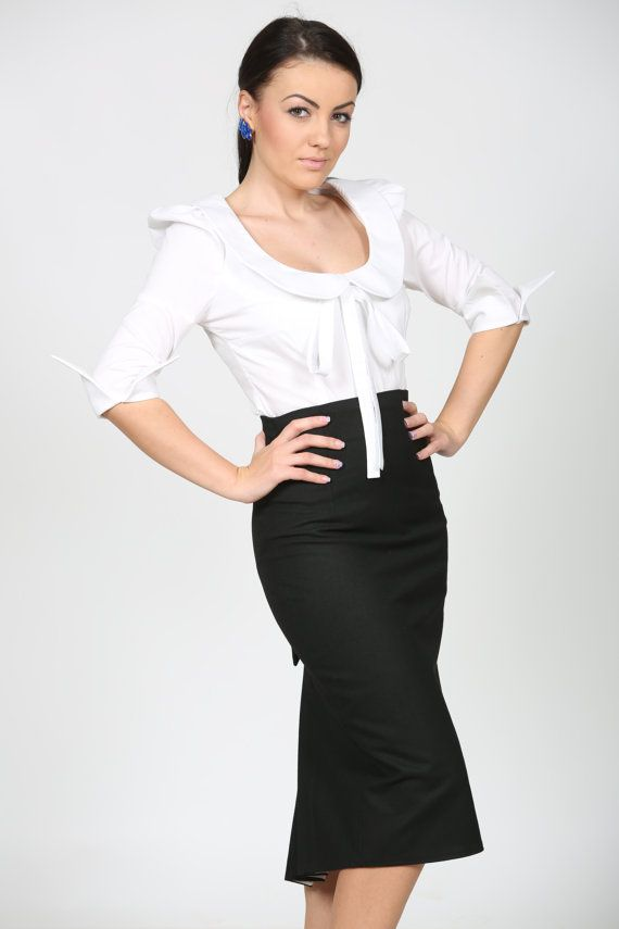 elegant skirt with peacock tail, wearable with any kind of blazer.  the fabric has a bit of elastan in it so it hugs your curves wonderfully.      s bust:82-83cm waist:63-64cm hips: 88-89cm  m bust:86-87cm waist:67-68cm hips: 92-93cm  l bust:90-91cm waist:71-72cm hips: 96-97cm    and larger :  42 - bust 94-95cm waist 75-76cm hips 100-101cm  44 - bust 99-100cm waist 80-81cm hips105-106cm  46 - bust 104-105cm waist 85-86cm hips 110-111cm  48 - bust 109-110cm waist 90-91cm hips 115-116cm