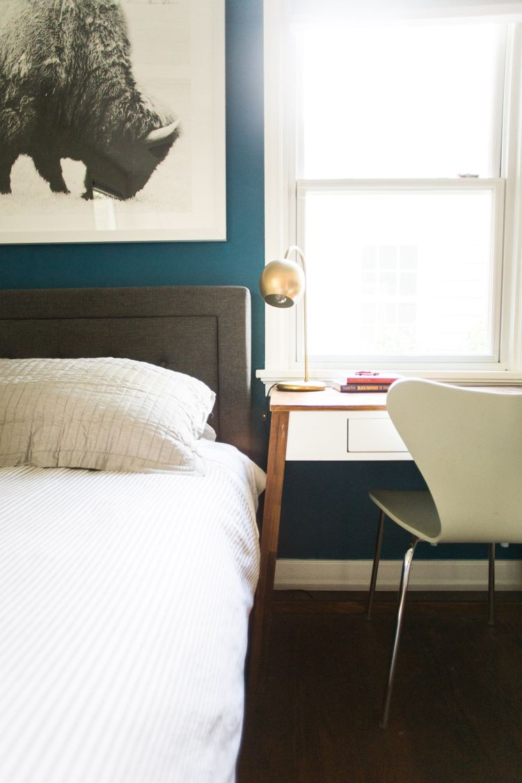 grownup kids bedroom with a blue accent wall  live free