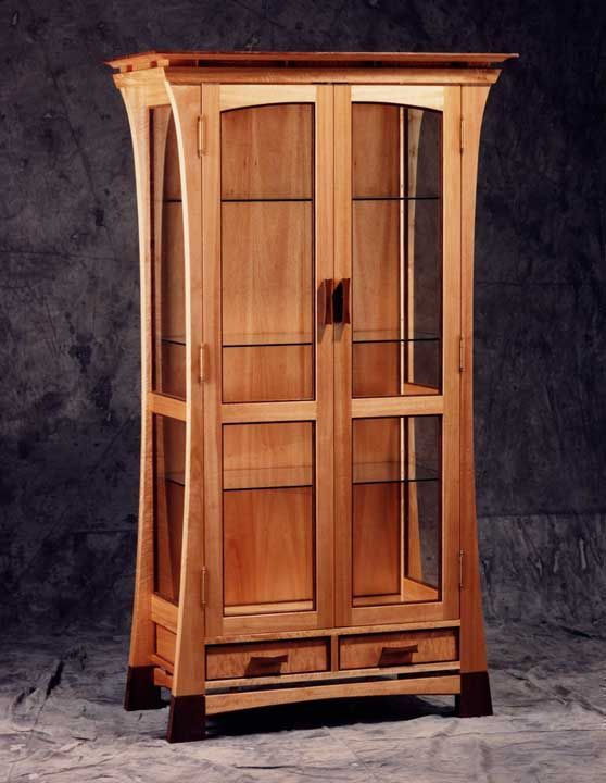 Curio Cabinet: A tall and skinny cabinet with glass doors and ...