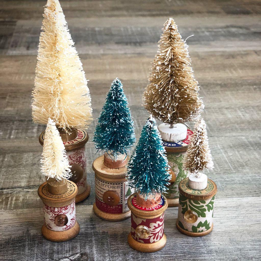 Tiny Bottle Brush Christmas Trees On Vintage Wood Spools Bottle Brush Christmas Trees Christmas Tree Decorations Diy Tiny Christmas Trees