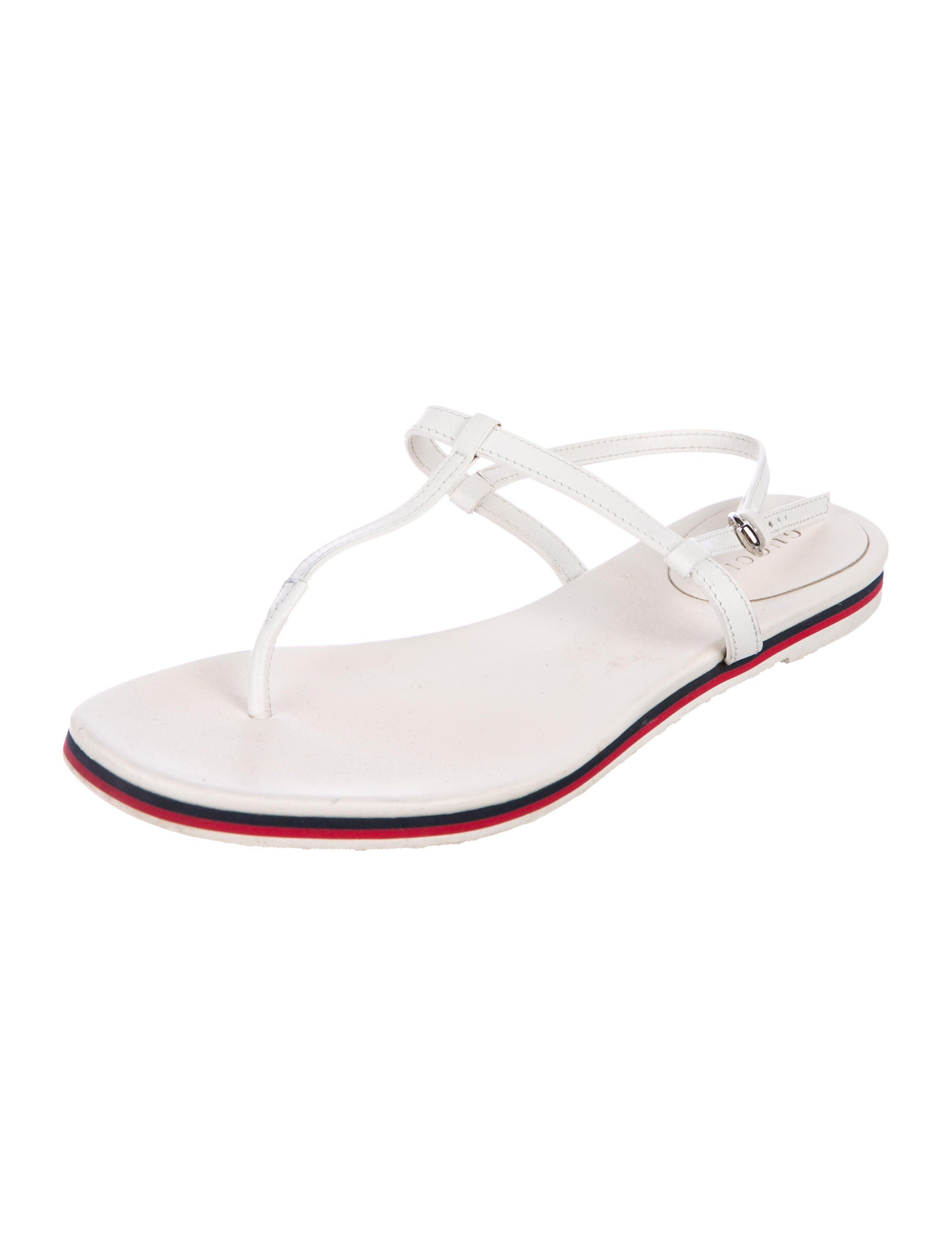 7de4ce7624bc White leather Gucci thong sandals with Web details at side straps and  stacked heels. Size not listed