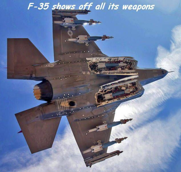 f 35 underside view of weapons bay open with missiles and bomb load awesome