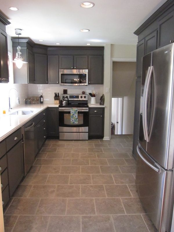 Charcoal Grey Kitchen Cabinets Crown molding and white counter tops
