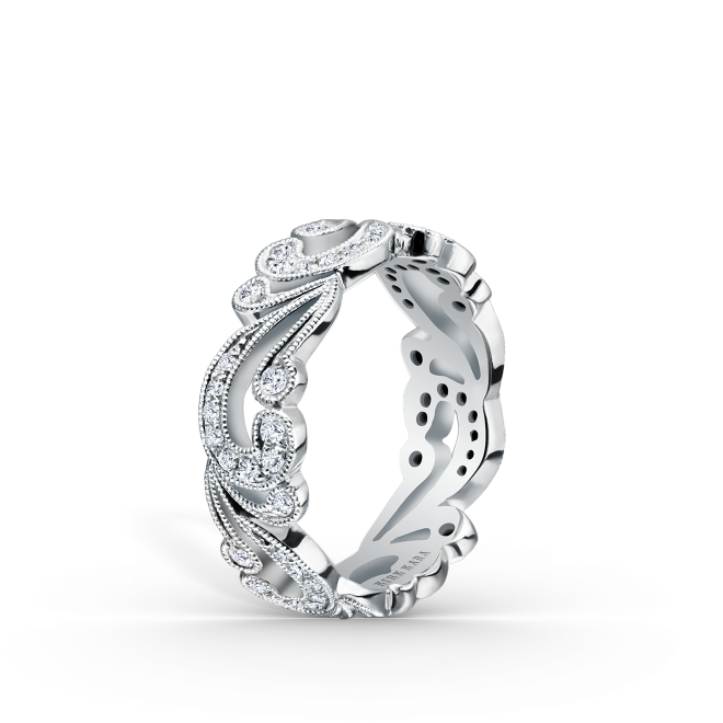 This whimsically chic, artistic design is a ladies' band from the Angelique collection. It features 0.35 ctw of diamonds and signature handcrafted milgrain edging.
