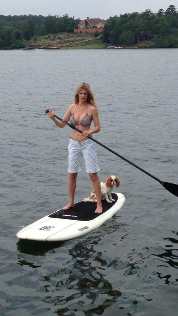 Kayla on her paddle board