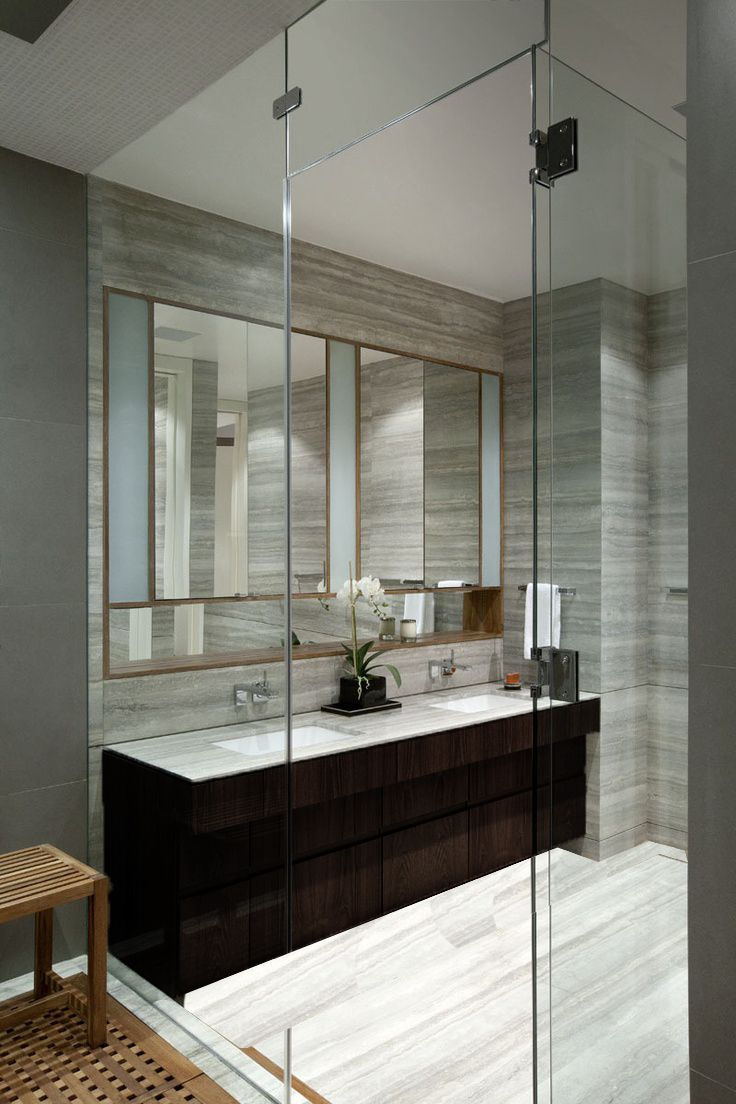 gray marble wall || dark cabinet || light gray marble floor