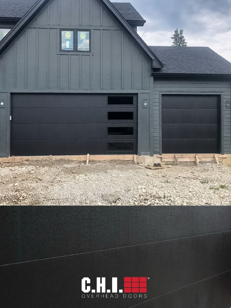 Matte Black Skyline Flush Garage Doors On Contemporary Custom Home In 2020 Garage Doors Modern Garage Doors Custom Homes
