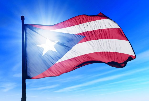 """The Flag of Puerto Rico is not based on the American Flag. It was adopted by the commonwealth of Puerto Rico in 1952, can be traced to 1868, when the first Puerto Rican flag, """"The Revolutionary Fla..."""