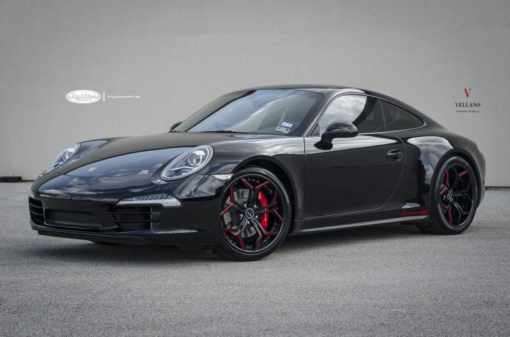 black porsche 911 carrera 4s with custom vellano rims in black with red windows