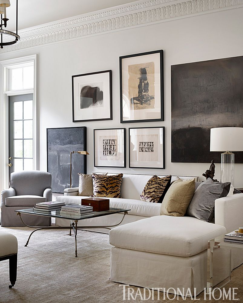 The Living Room Manchester Gallery: A Sprawling Sectional Adorned With Animal Print Pillows