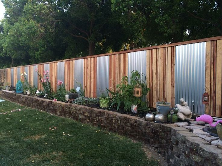 Cinder Block Retaining Wall With Fence On Top Privacy Fence Landscaping Backyard Fences Privacy Fence Designs