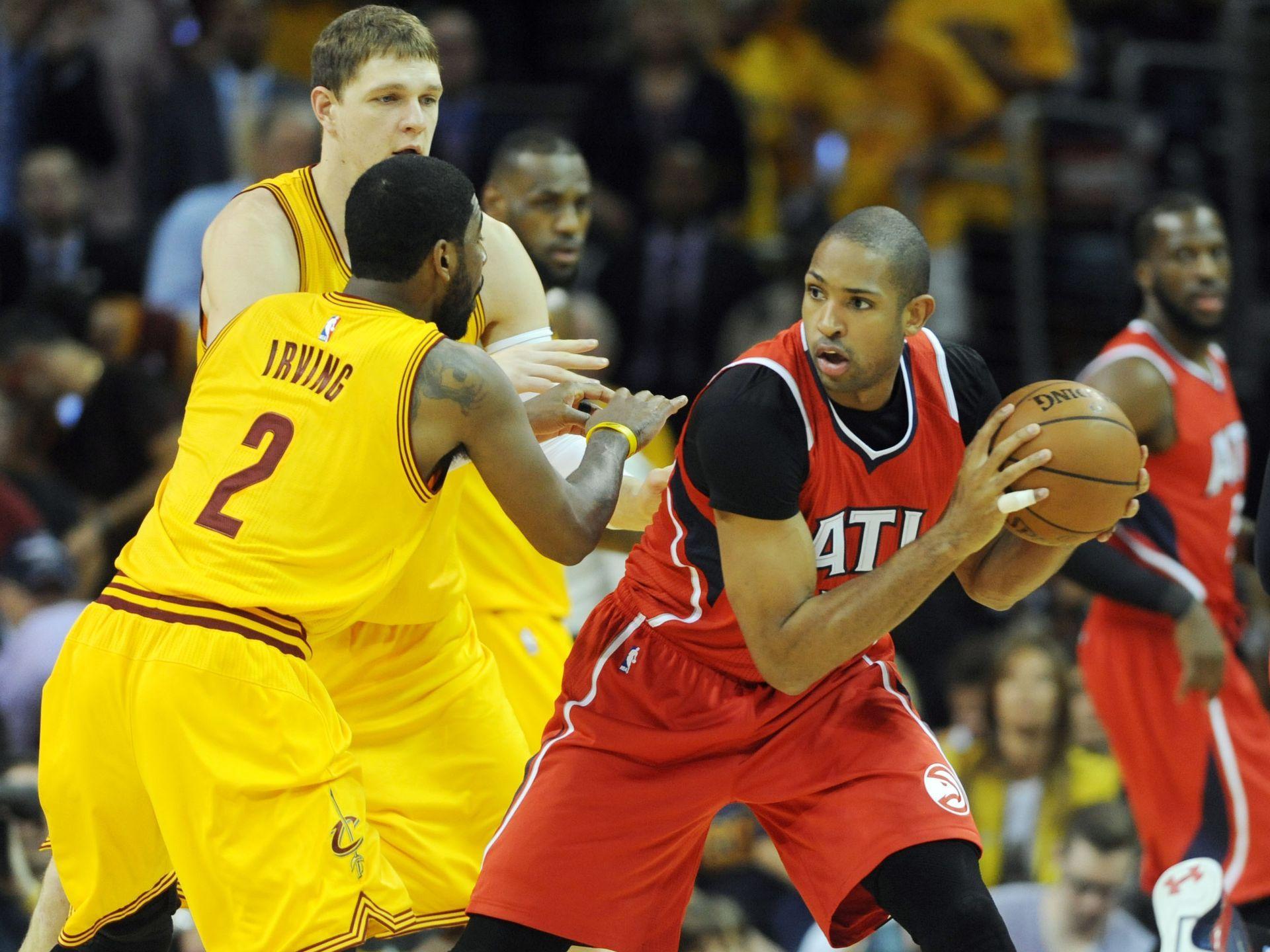 Cleveland Cavaliers' Tristan Thompson gets past Atlanta Hawks defenders  Kent Bazemore, Paul Millsap,
