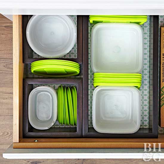 To make instant drawer compartments and create a space for your lids without toppling, invest in a few decorative box shelves. Get a few that vary in size, drop them directly into a drawer, and keep containers and lids easily grouped in size-appropriate compartments. This method will keep your food containers sorted and will prevent stacks of lids from sliding around the drawer.
