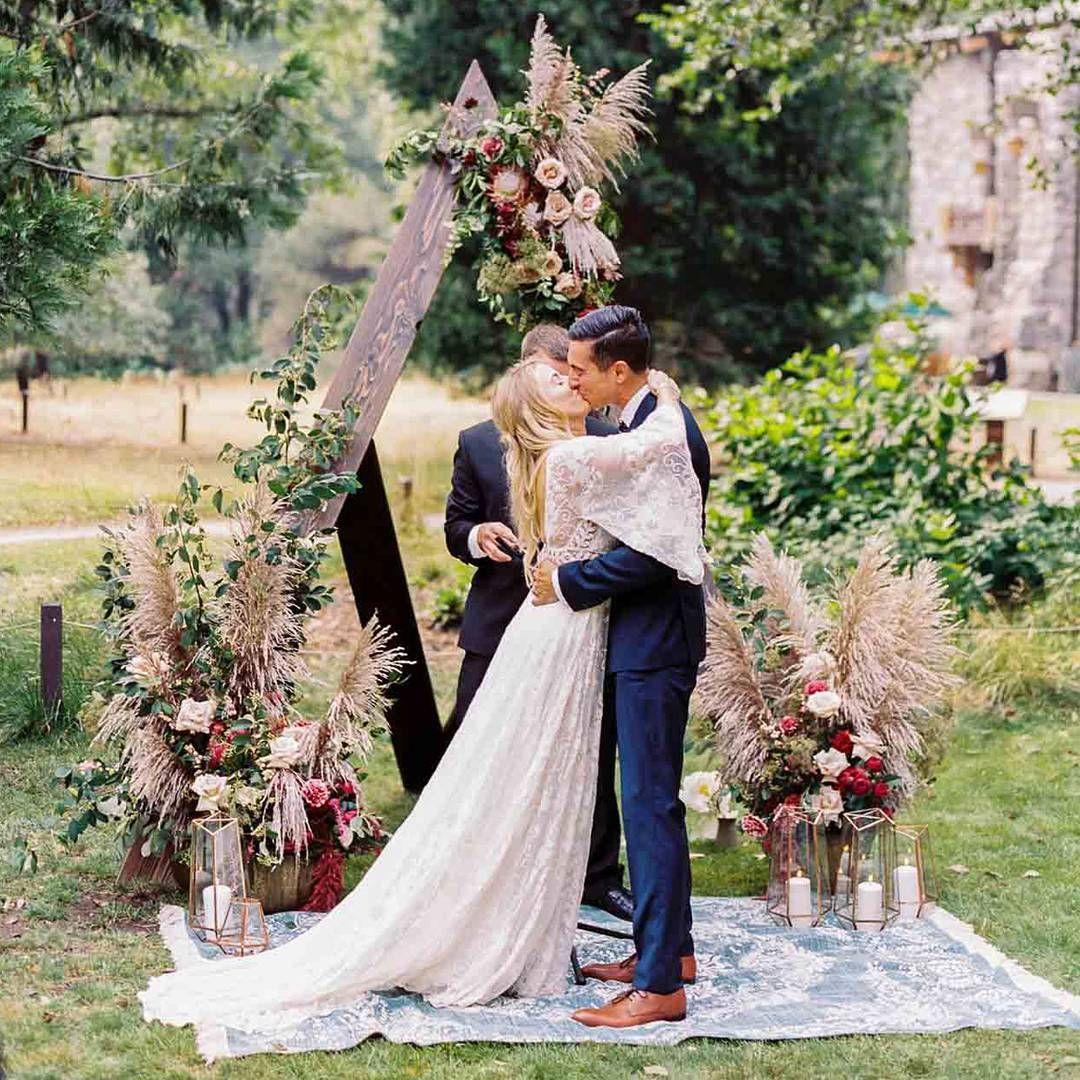 From the boho bridal dress to the teal velvet linens custom table