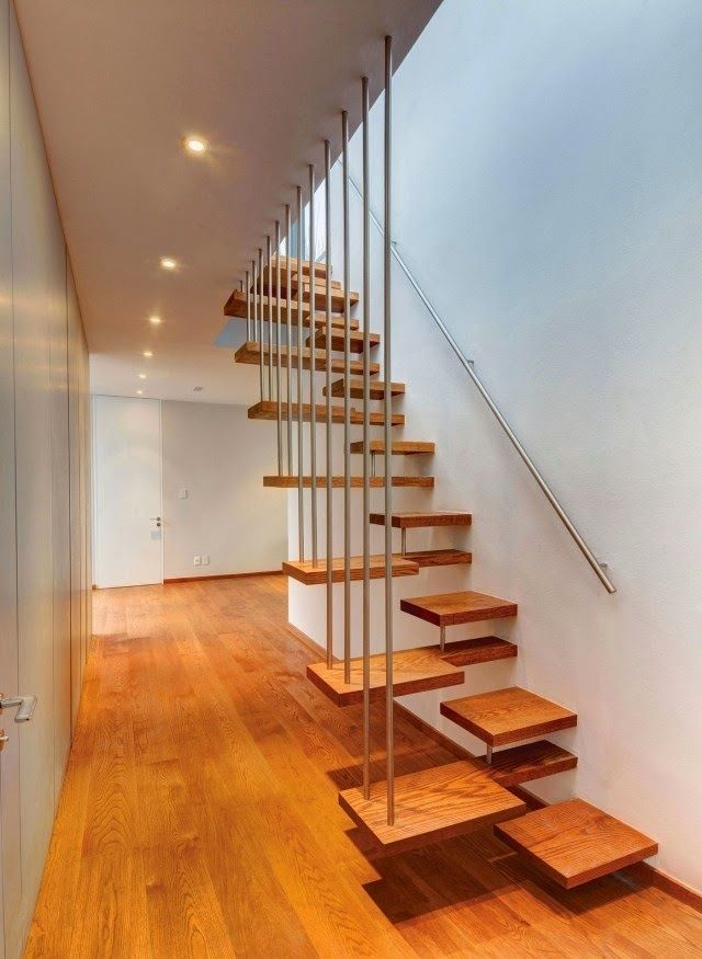 interior stairs design: modern wooden stair design with metal handrail