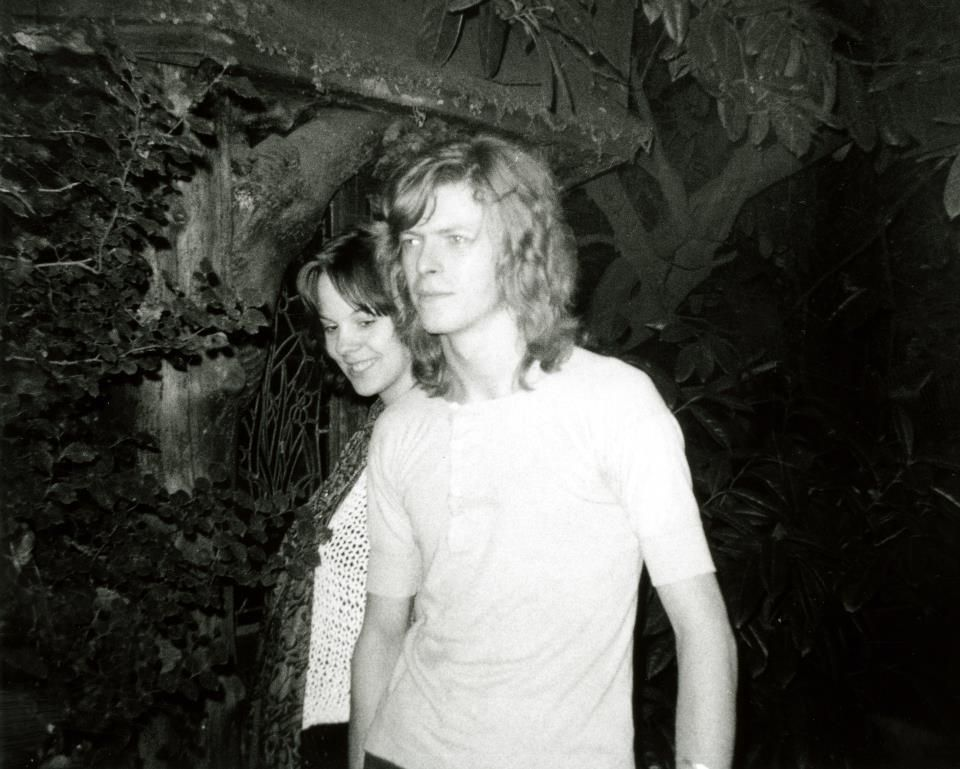 Sarah-Rena Hine & David Bowie holding hands in the garden of Haddon Hall Photo: Mick Ronson © 1969 Hine, Dragon Press Agency Autumn 1969 In the garden of Haddon Hall, Flat 7, 42 Southend Road, Beckenham. where David moved to in October 1969 created his 2nd.album Space oddity and Ziggy Stardust.