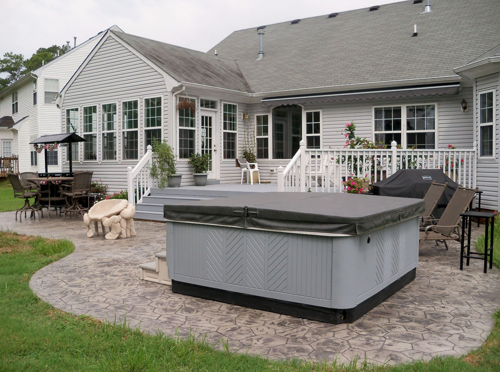 Patio ideas with hot tub - Stamped Concrete Patio And Hot Tub