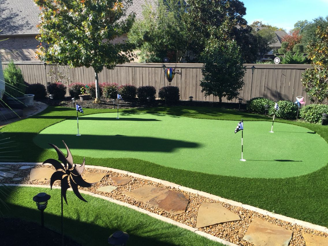 Small backyard putting green. No maintenance, lots of fun, and looks great all year round! #backyardremodel