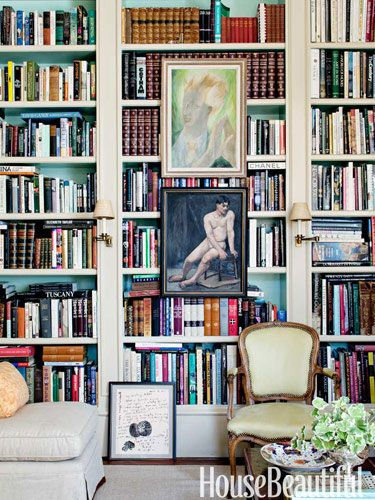 a portrait of conductor leopold stokowski and a figure study are focal points on the library bookshelf design alex hitz - Bookshelves Los Angeles