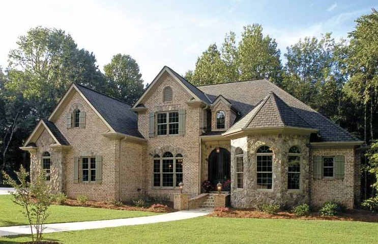 French Country Inspired Homes For A Rustic Look Brick Wall Grey Roof Green Lawn Trad French Country House Plans Country Style House Plans French Country House