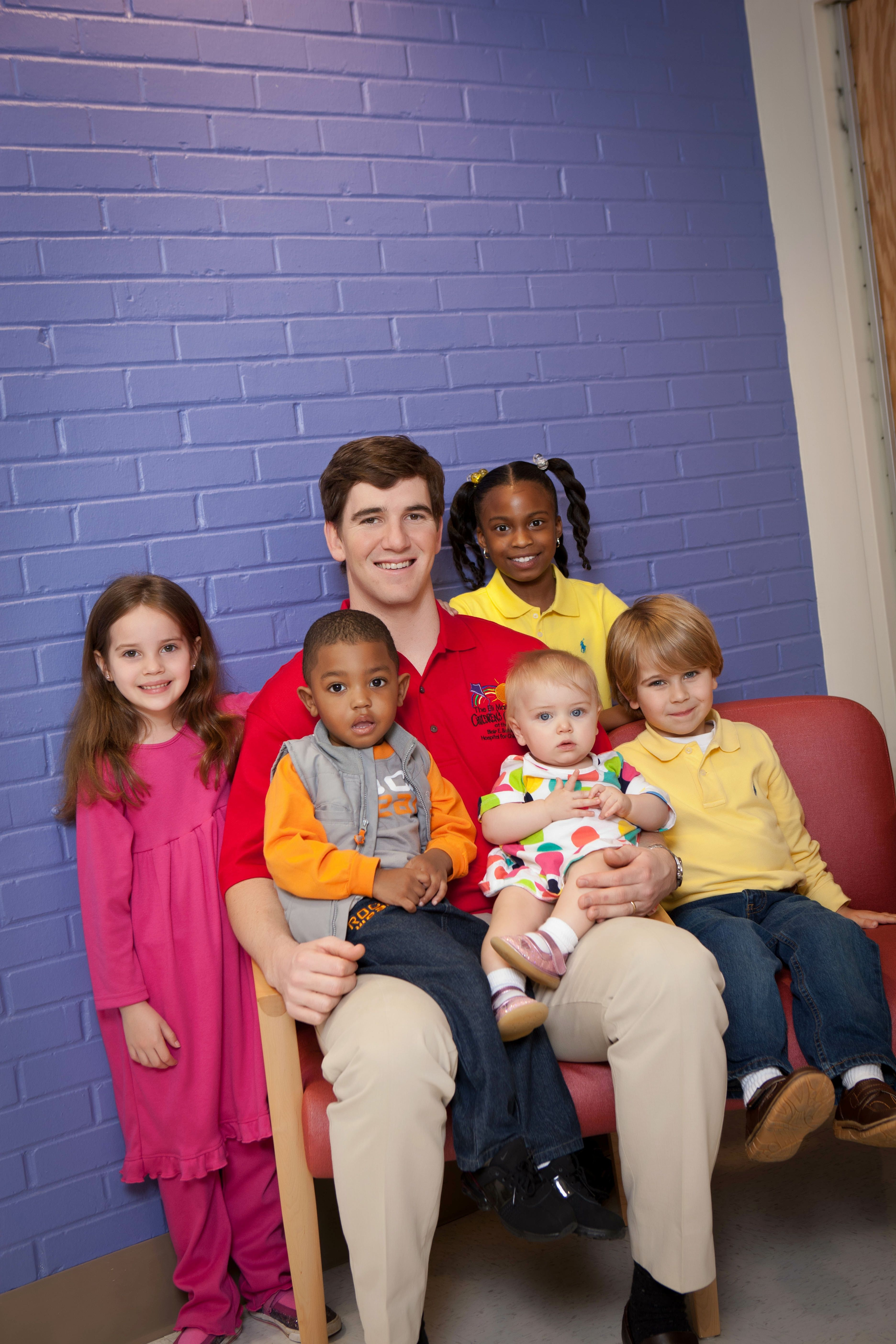 Eli visits with patients at the Eli Manning Children s Clinics at
