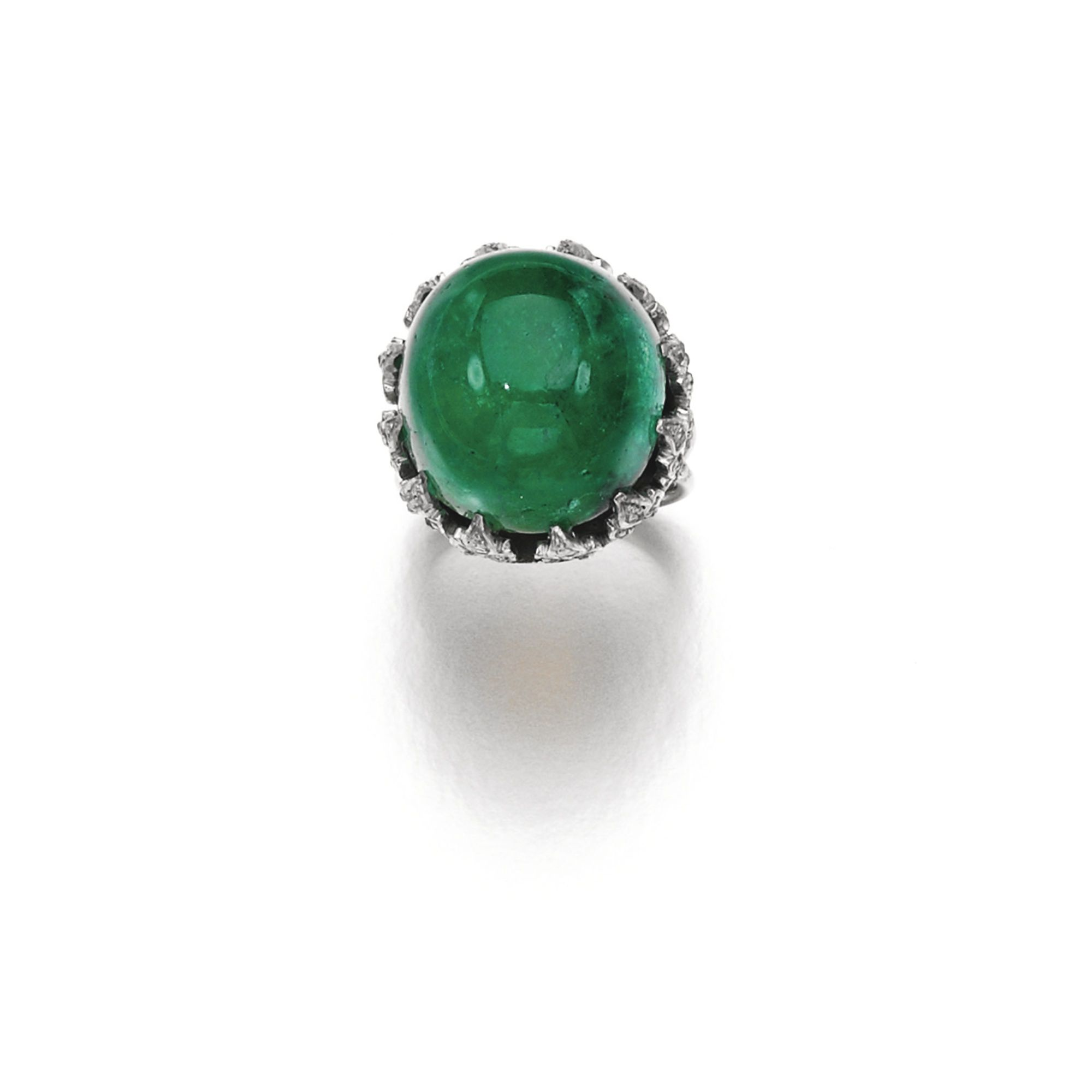 Emerald and diamond ring clawset with a cabochon emerald the