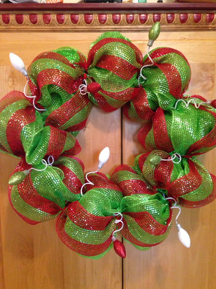 Red and green decomesh wreath with glittery lightbulbs! Follow me on Instagram @michelleajo