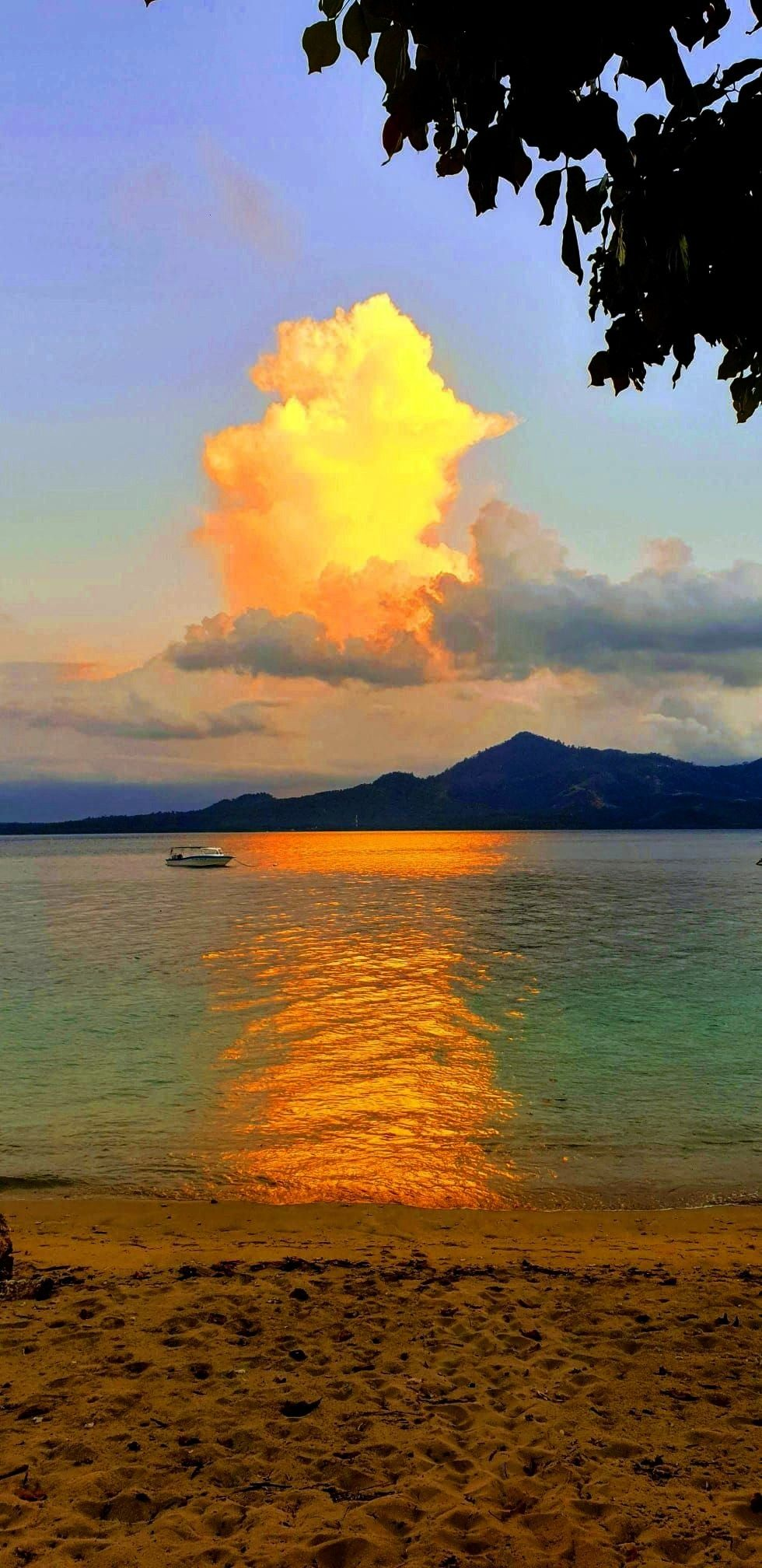 is painted in different colors every day when the sun sets over Siladen Island. A fantastic and uni