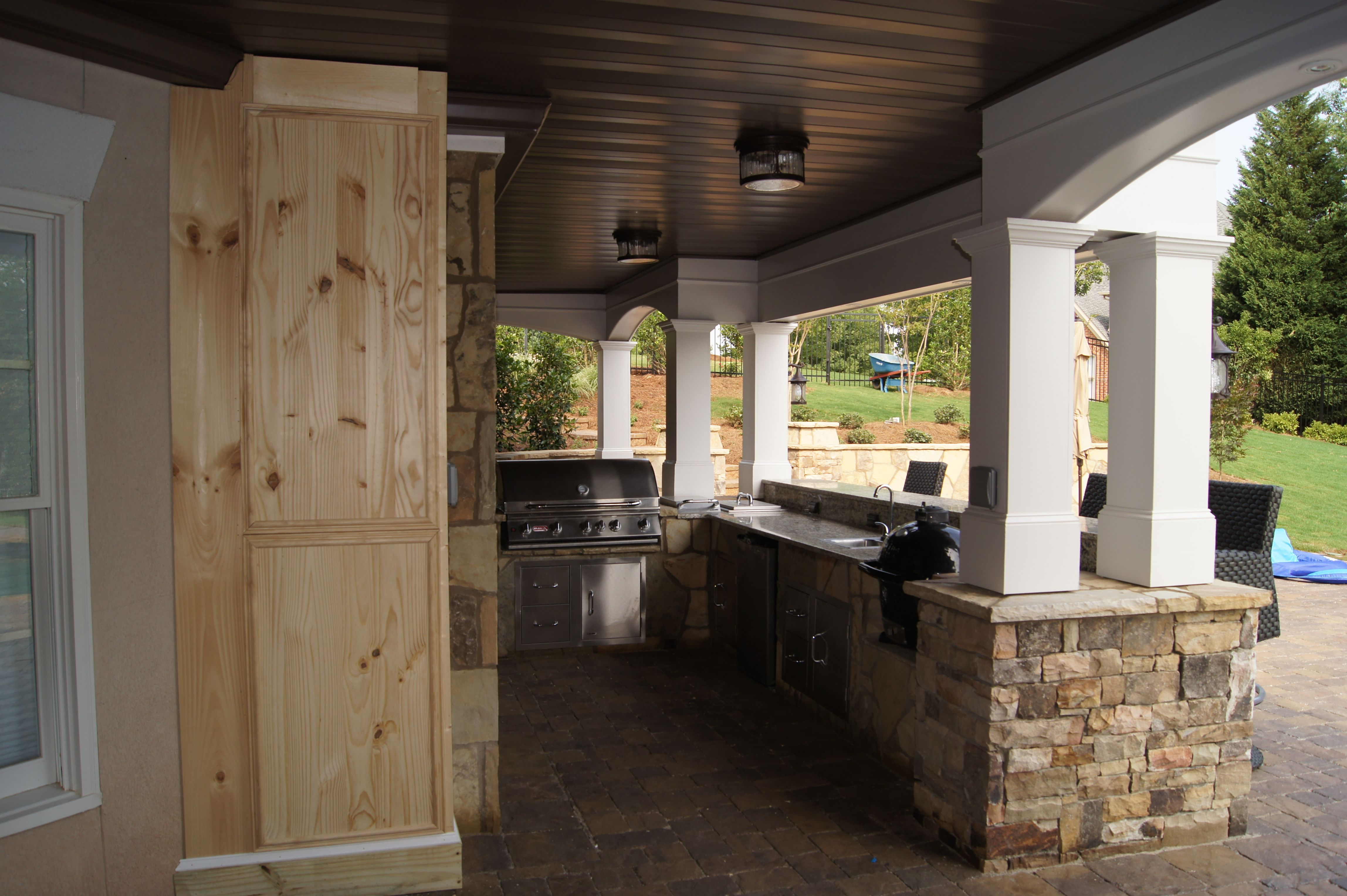 this food bar area was designed as a nook under the deck to enjoy meals and refreshments on outdoor kitchen on deck id=41320