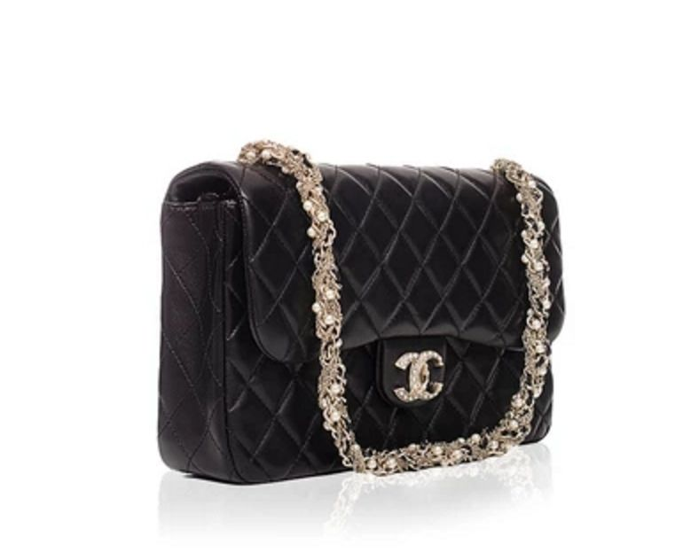 a3479b7b5d4e Get the trendiest Clutch of the season! The Chanel Limited Edition  Westminster Pearl Flap Black Clutch is a top 10 member favorite on Tradesy.