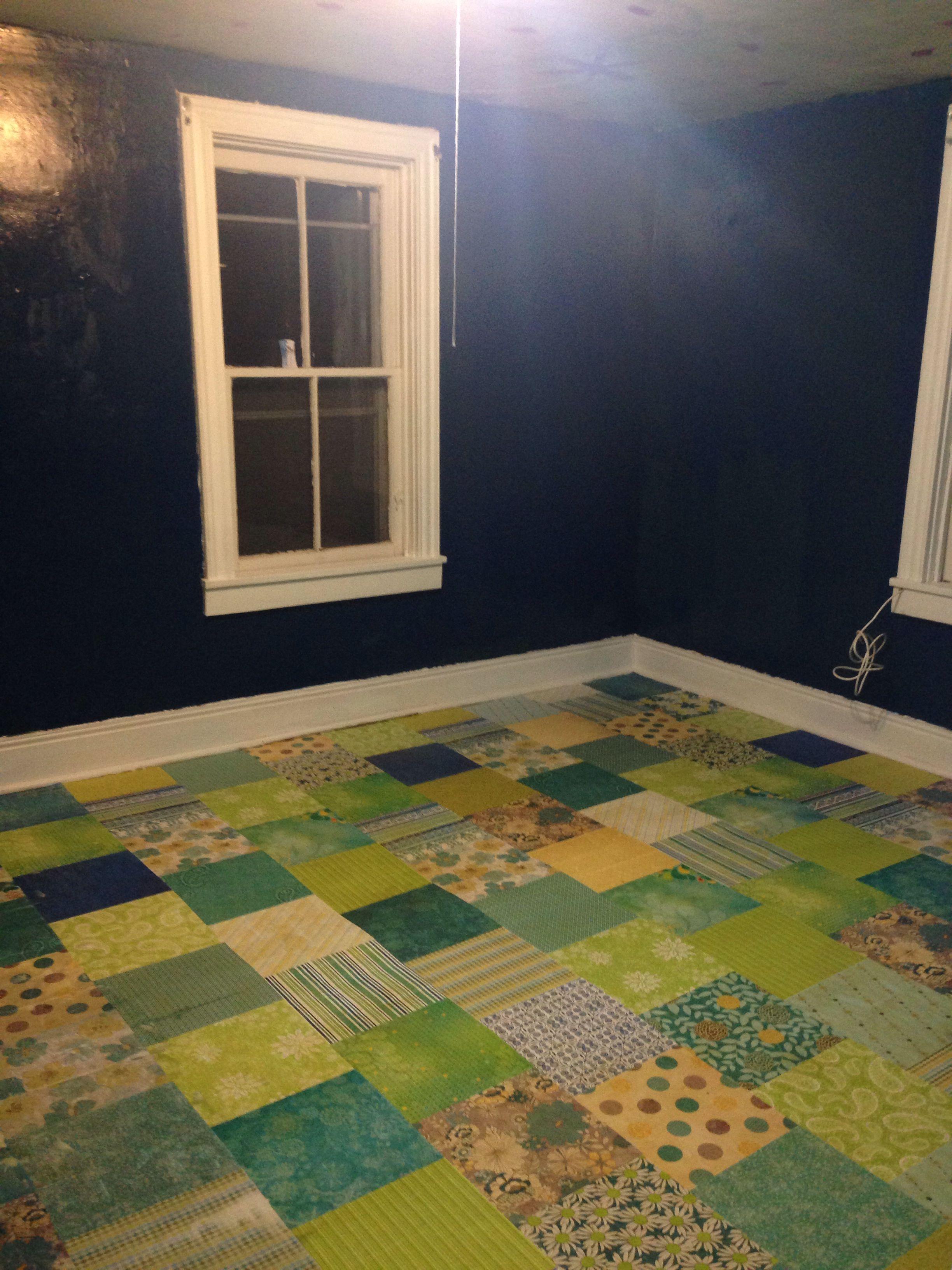 Scrapbook paper floor over wood.