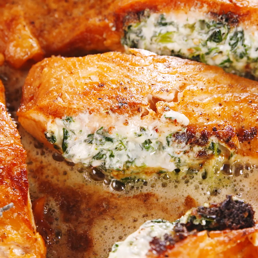 Stuffing creamed spinach into salmon is one of the best things you can do with seafood. Get the recipe at .
