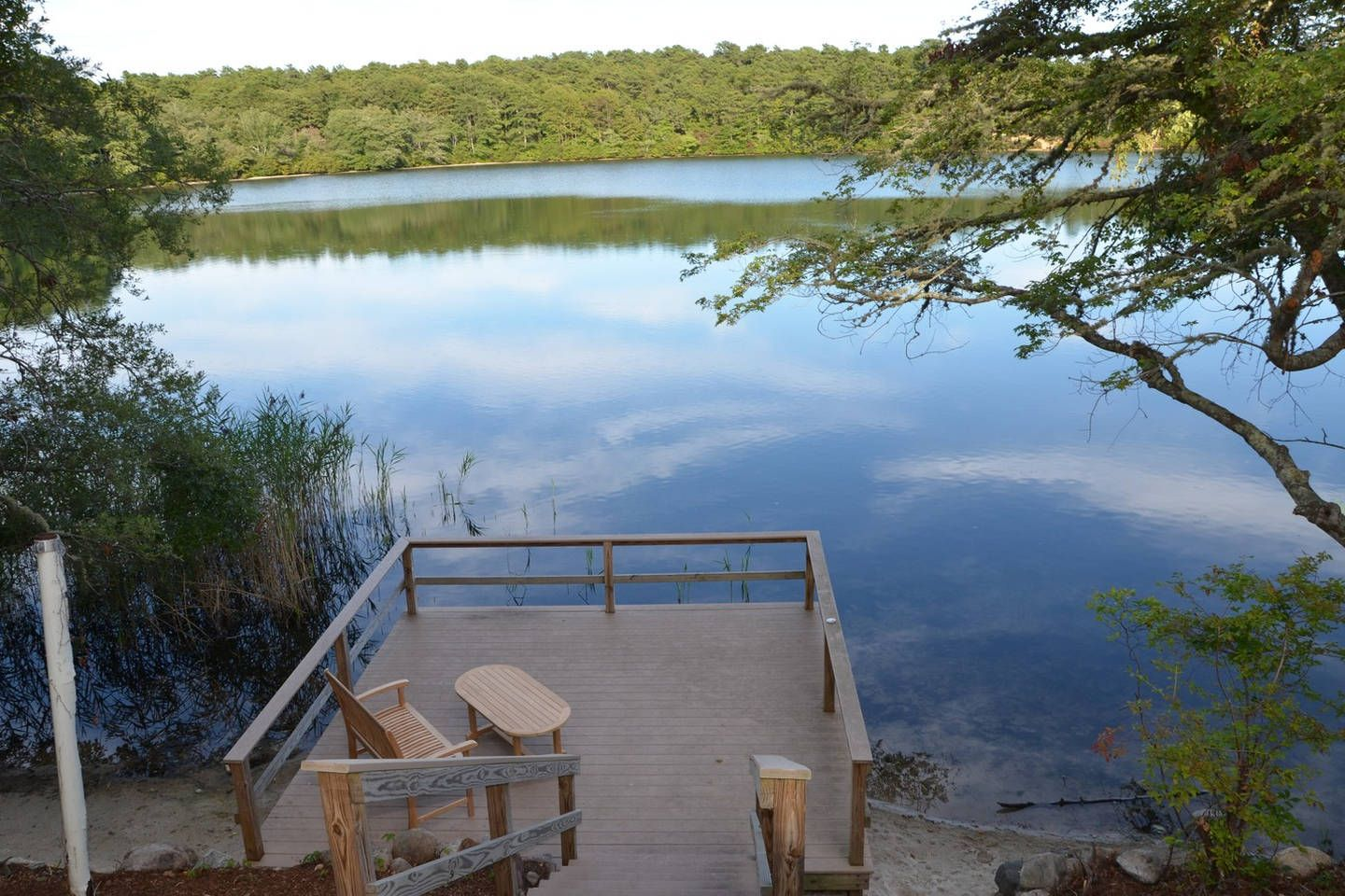 Stunning waterfront home on Flax Pond. Rated 2nd best pond