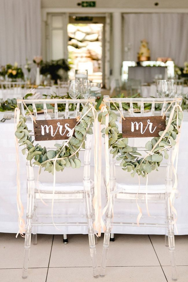 Chairs With Greenery Wreaths And Wood Mr Mrs Signs