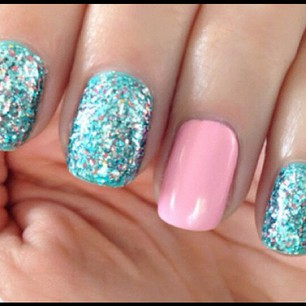 sparkly teal and bubble gum pink nails.