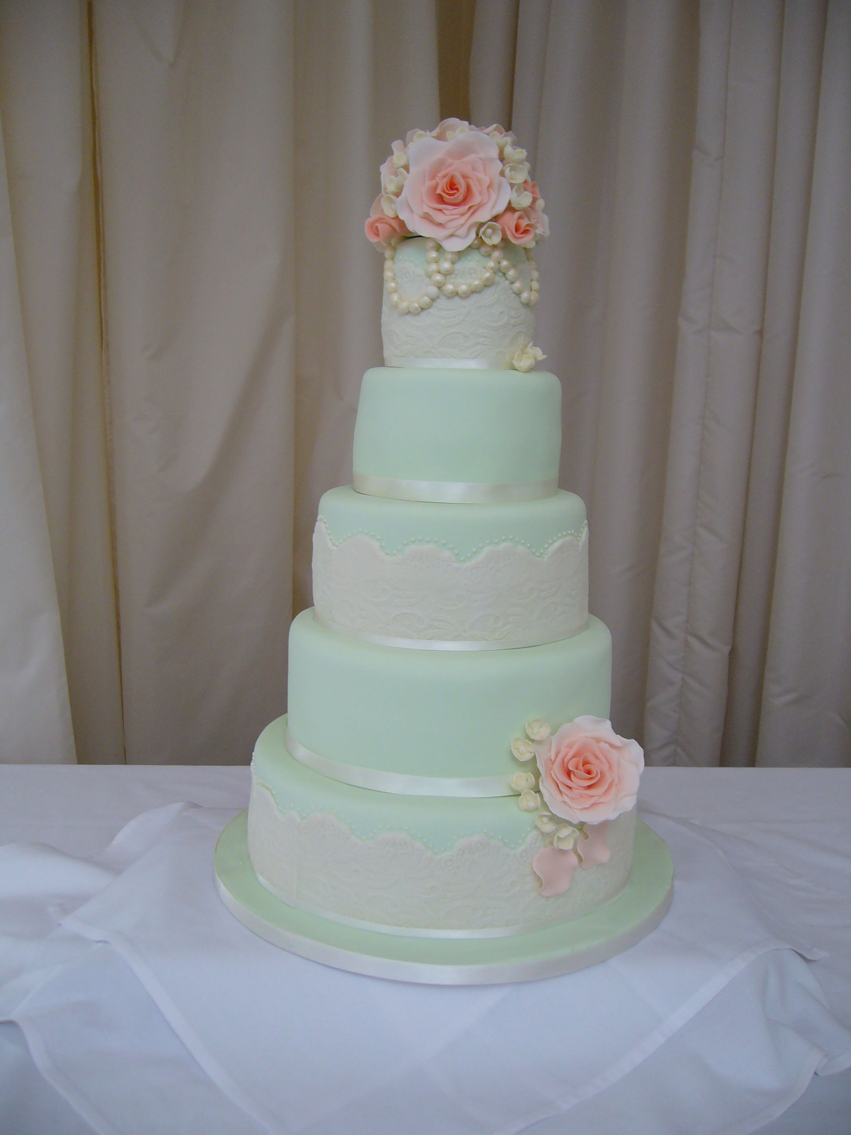 shabby chic bridal shower cakes%0A Soft mint green five tier wedding cake with apricot sugar roses  Vintage  wedding cake
