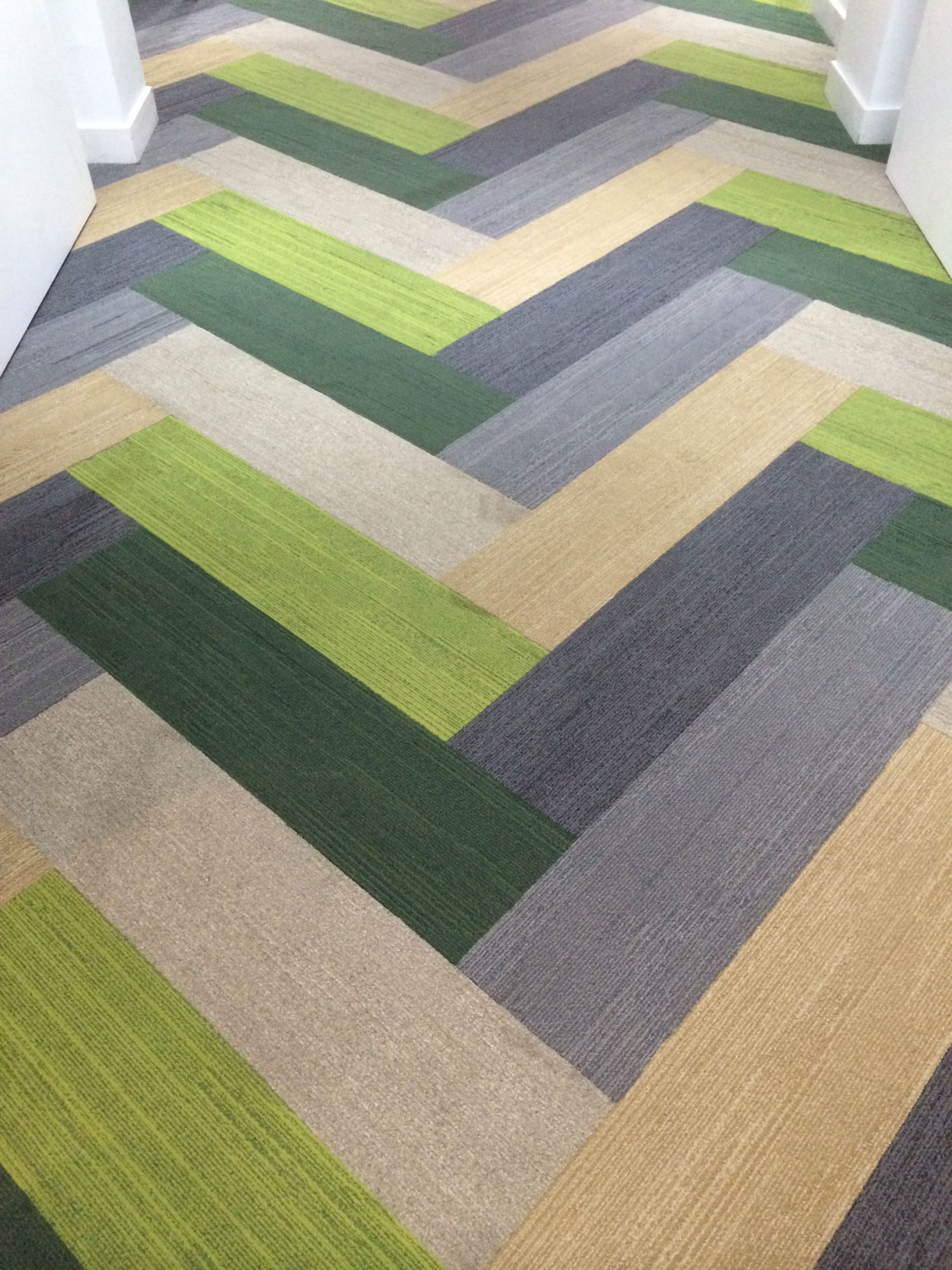 Plank carpet tiles in a herringbone pattern plank carpet tiles plank carpet tiles by interface i love this idea for an outdoor carpet pattern for my porch would go great with the green couch and grey flooring baanklon Choice Image