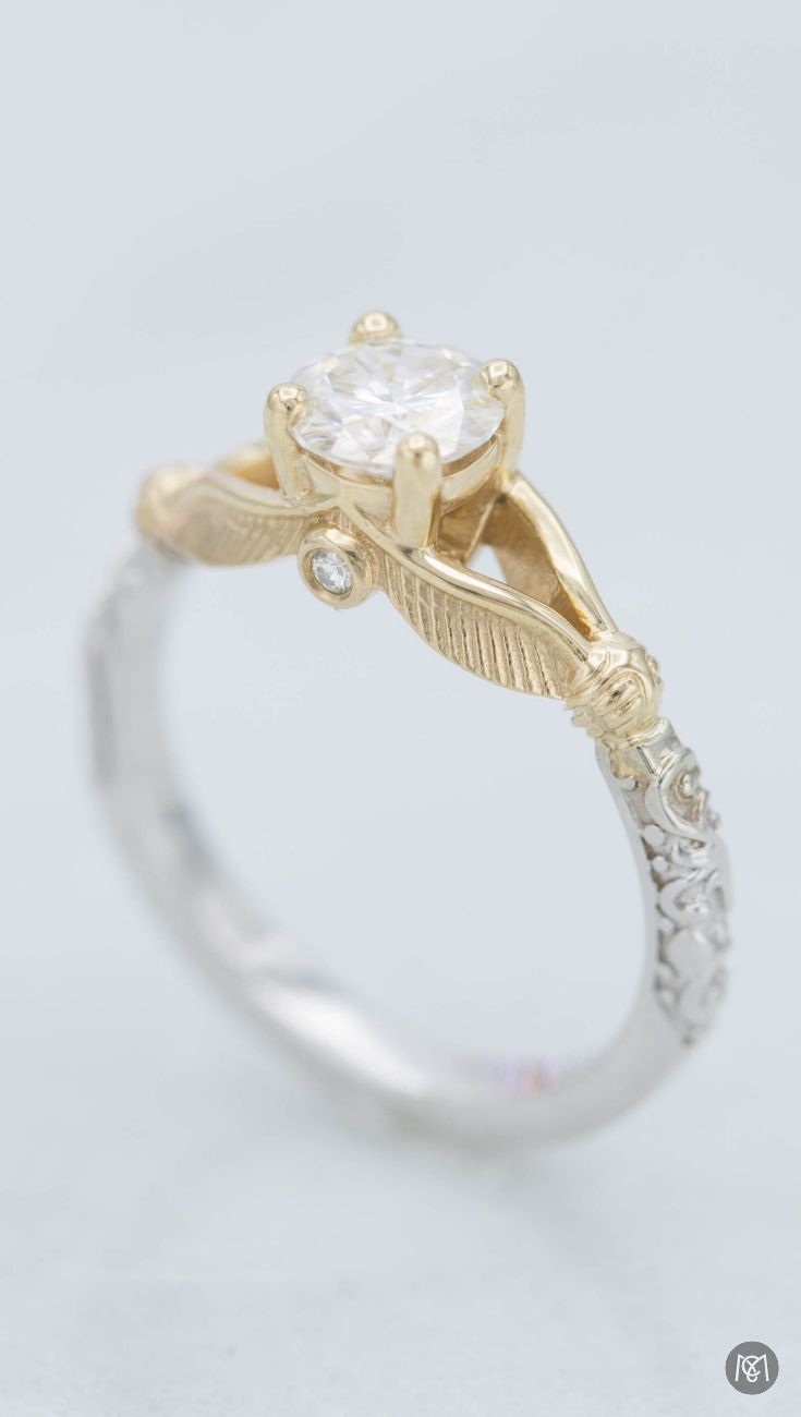A wonderful mixed metal engagement ring inspired by harry