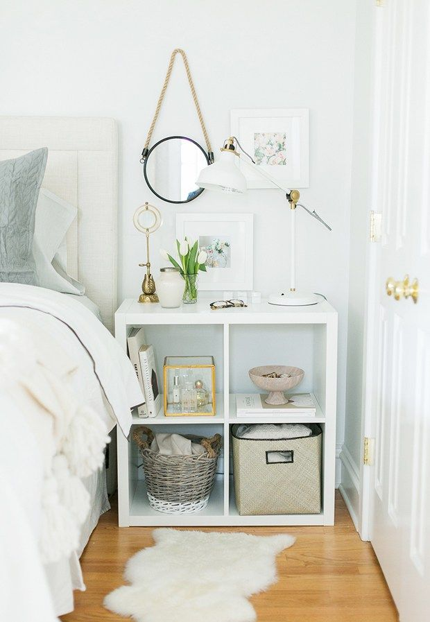 A white bedroom featuring an IKEA expedit shelf as a bedside table, via The Everygirl, via @sarahsarna.